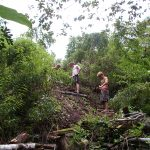 Volunteers work on the trails of Hedonisia