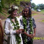 Hawaiian wedding couple walk with retinue